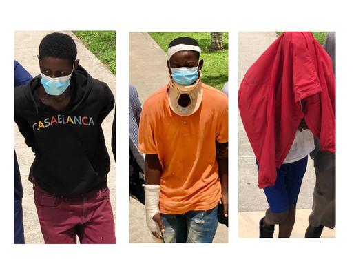 men beaten by vigilantes charged