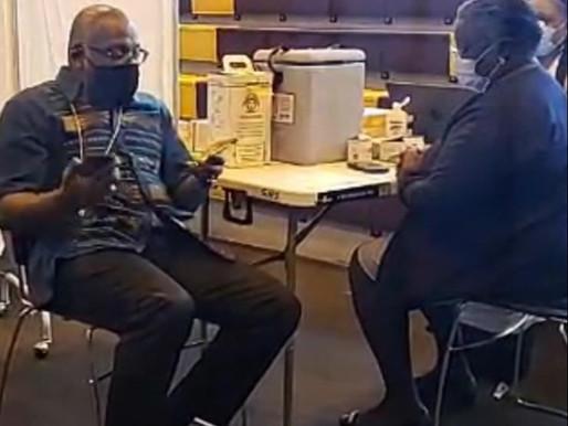 Bishop Neil Ellis receives first vaccine shot