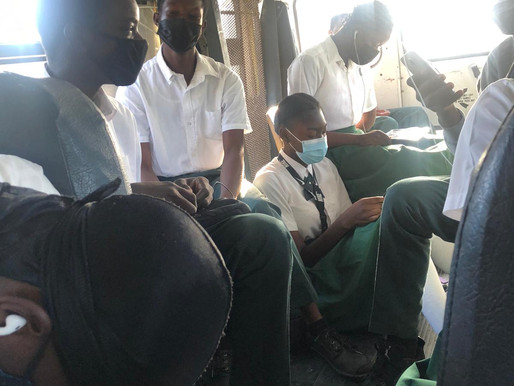 Andros students riding on school bus floor