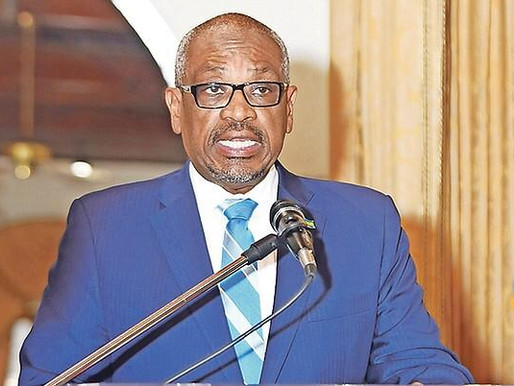 Minnis travels as government struggles to pay bills