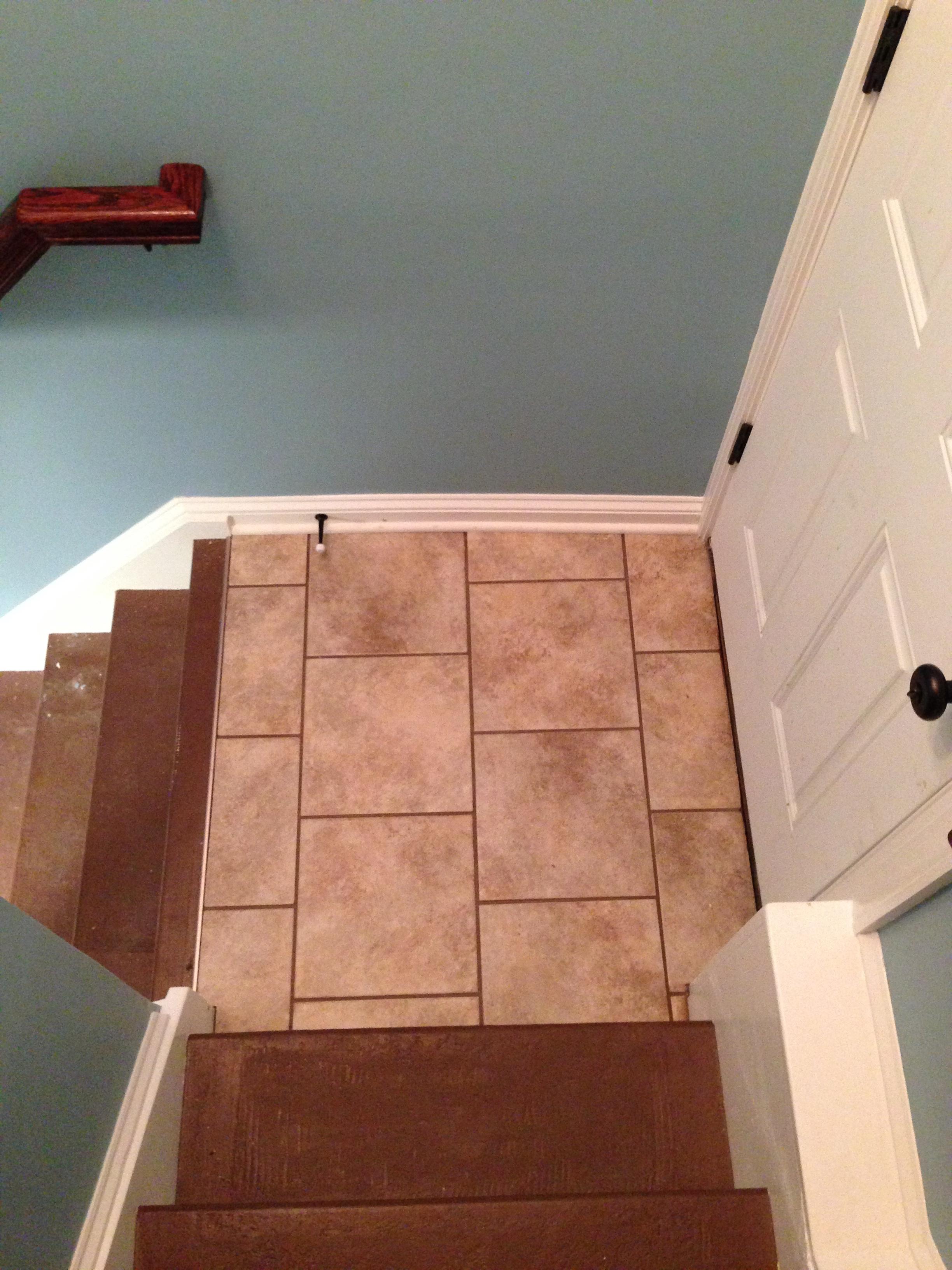 Tiling at top landing