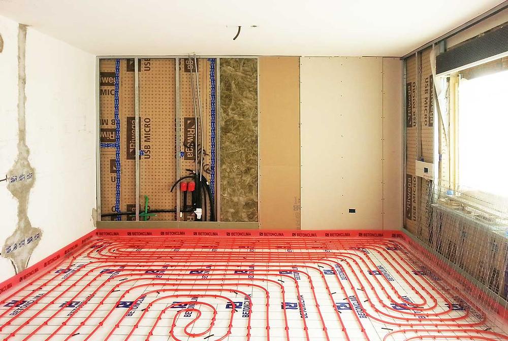Intervento di riqualificazione involucro impianto in vecchio edificio condominiale con cappotto interno e riscaldamento a pavimento