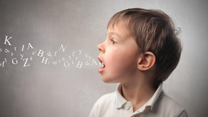 How does visual performance affect speech development in autism?