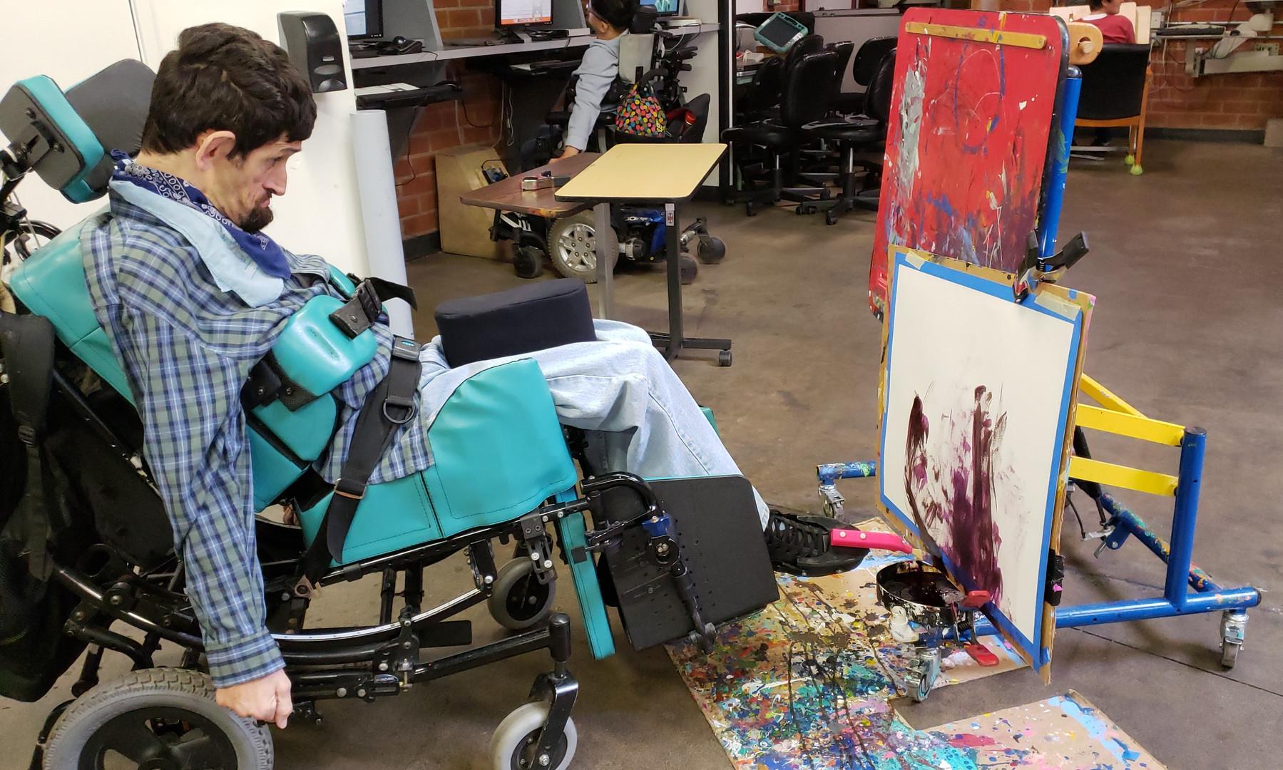 Paul Hassan utilizing an adaptive foot tool.