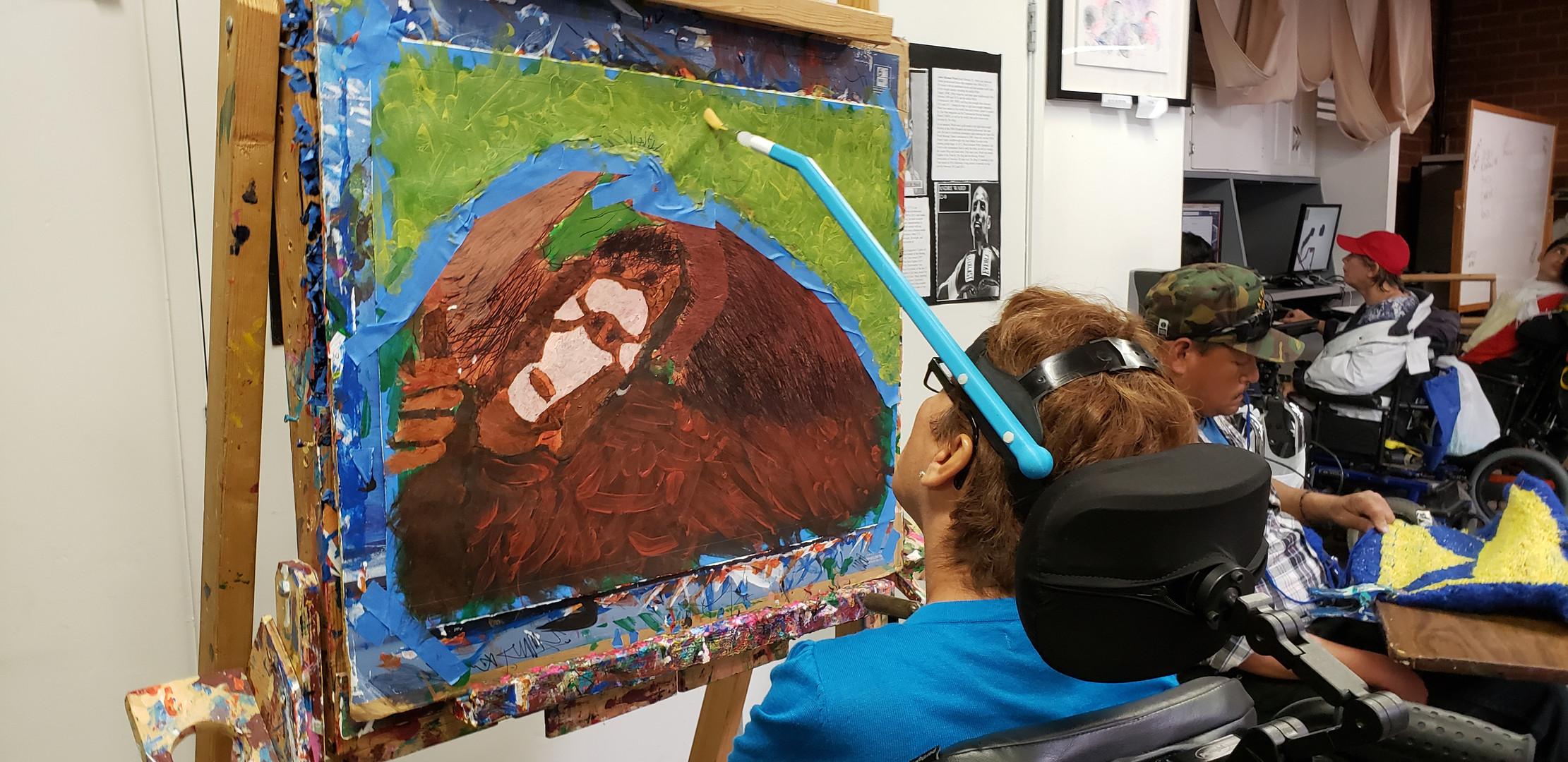 Beatrice Olea utilizing an adaptive head tool.