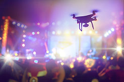 Drone silhouette flying above live conce