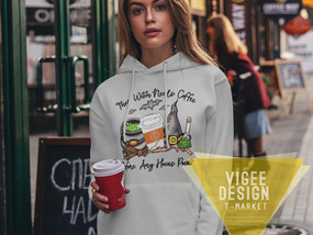 mockup-of-a-woman-wearing-a-customizable-hoodie-and-holding-a-coffee-4780-el1 (1)_edited.j