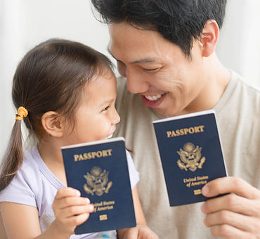 Man and his daughter are happy to receive US passports. High quality photo.jpg