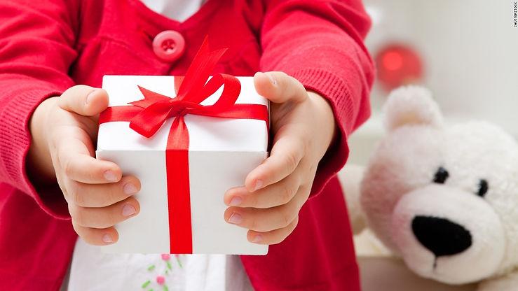 151125093311-kid-giving-present-super-te