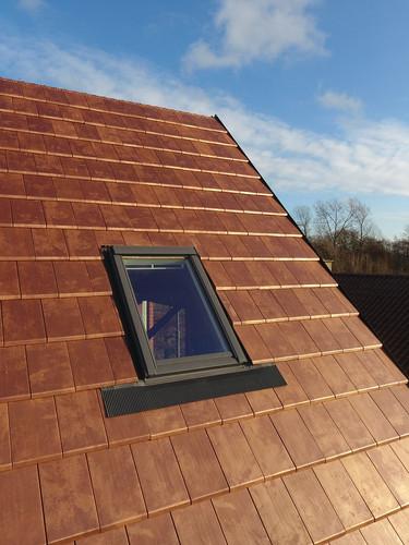 koper dak met keramische pannen