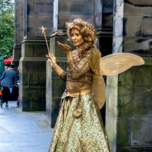 (393) Gold Fairy Street Performer on Roy
