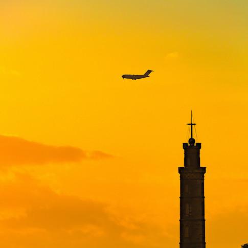 (795) Plane flying over The Nelson Monum