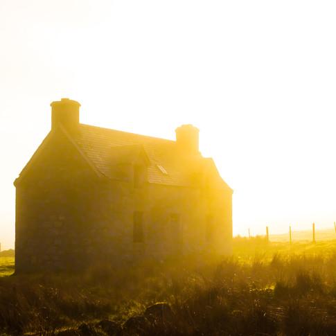 Abandonded Croft House Against Mist and Sun.