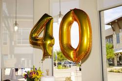 Over-sized balloons over dessert bar