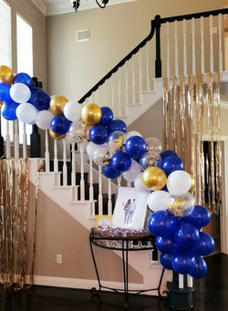Entrance balloon garland and stair decor