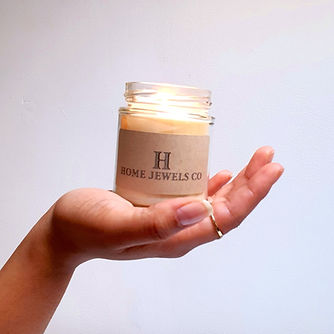 Lit 8oz Home Jewels Co soy candle in ope