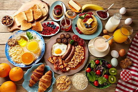 Breakfast buffet full continental and english coffee orange juice salad croissant fruit.jpg