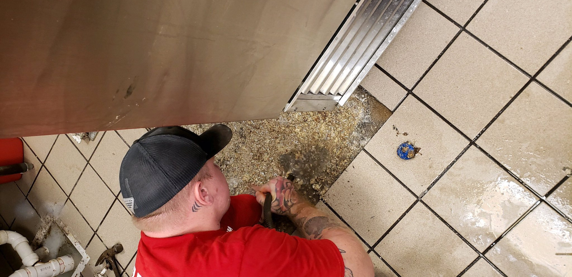 EZ-Flow Plumbing cleaning out a Grease Trap