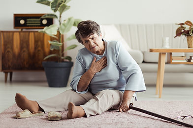 Disabled elder lady sitting on the floor