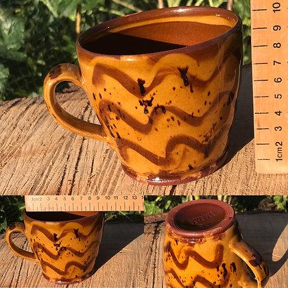 Hand-thrown pottery slipware mug