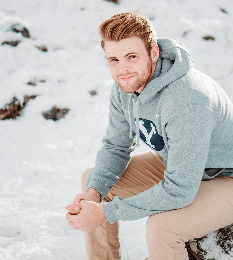 young redheaded guy sitting on the snow