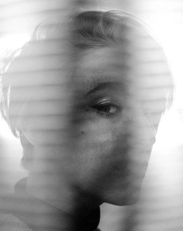 monochrome headshot of girl behind transparent fabric