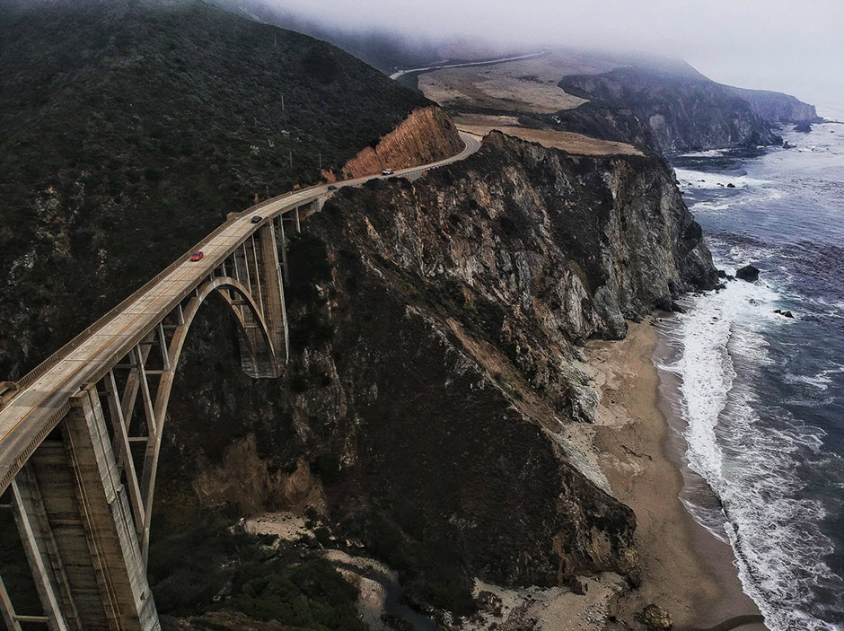 road over cliff and sea at bixby creek bridge on the big sur coast ofcalifornia