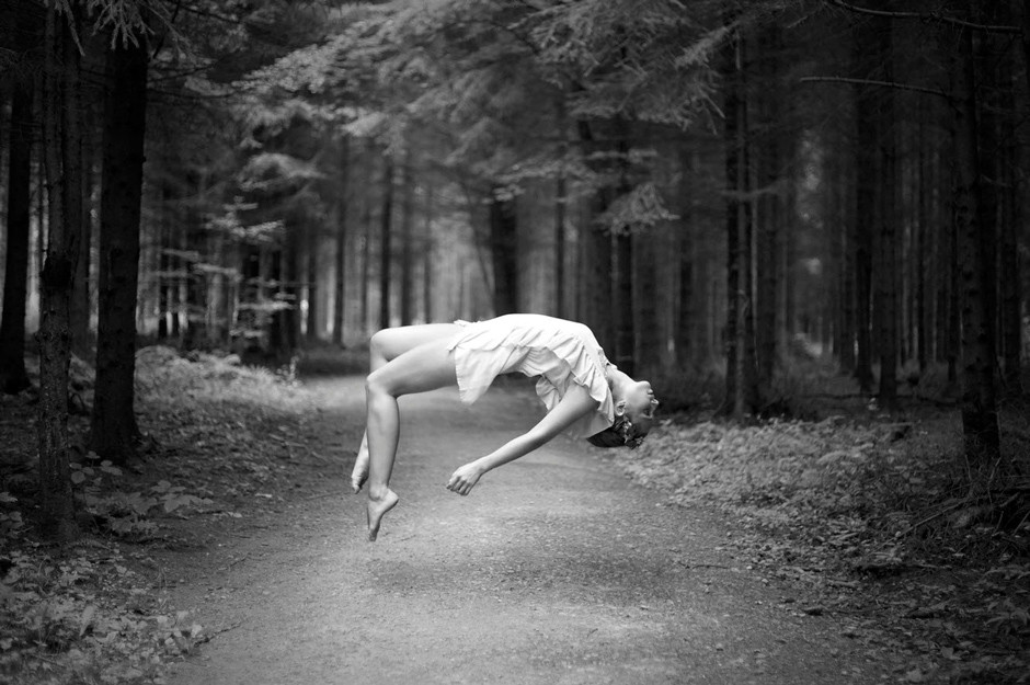 portrait of girl levitating in a forest