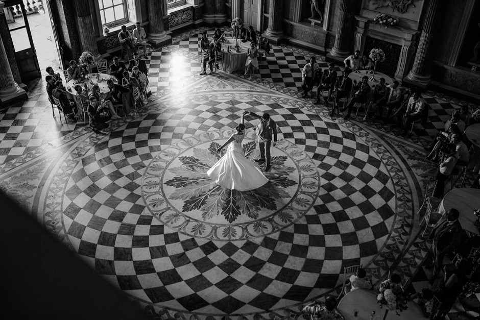 couple having their first wedding dance in a beautiful hall