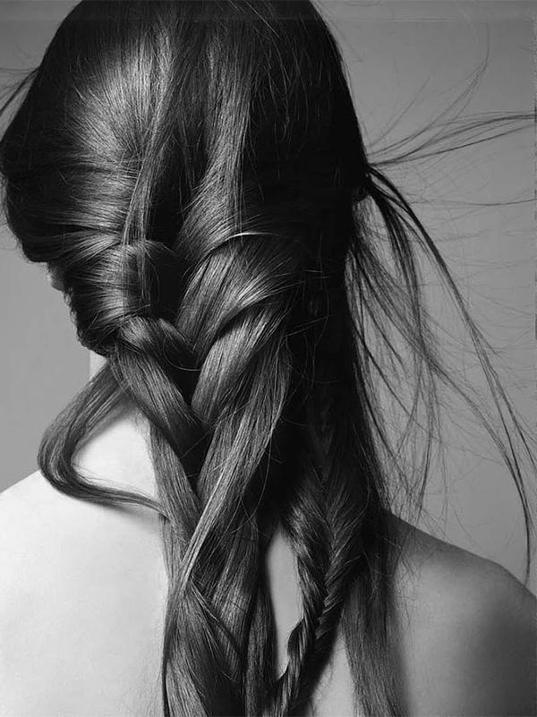 monochrome image of long braided hair