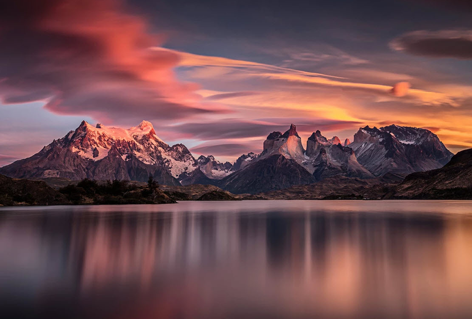 long exposure colorful sunset over mountains and lake