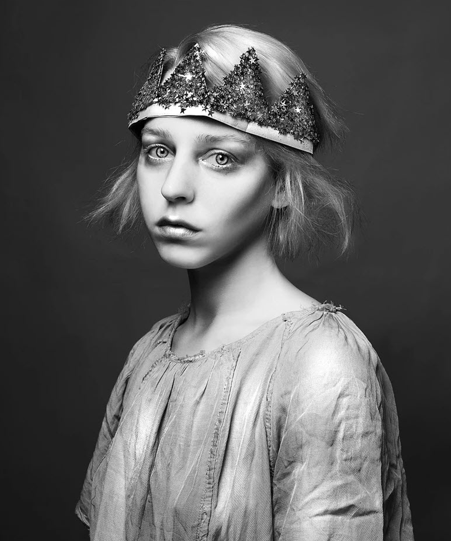 black and white portrait of girl with a crown covered in sparkles