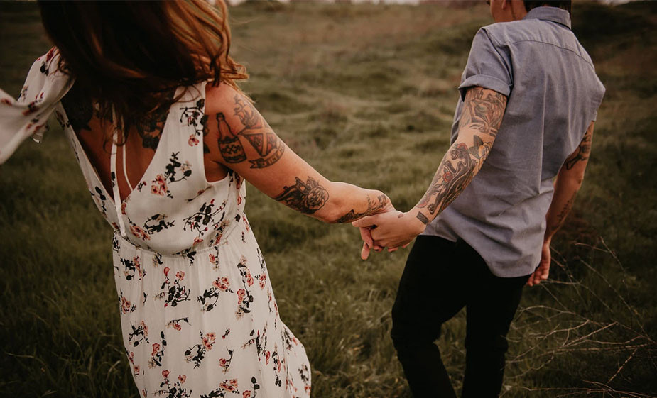 tattooed lesbian couple holding hands portrait