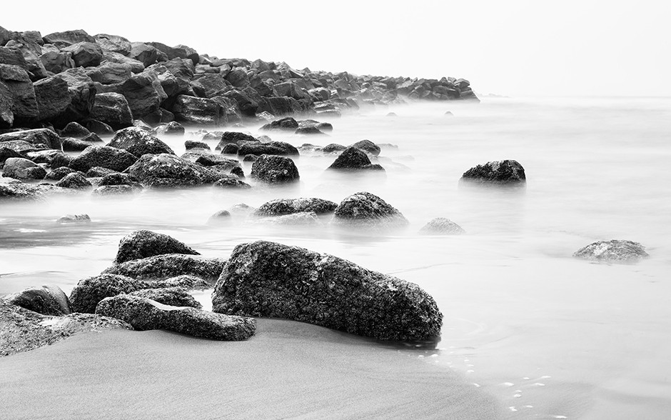 black and white long exposure photography waves and beach