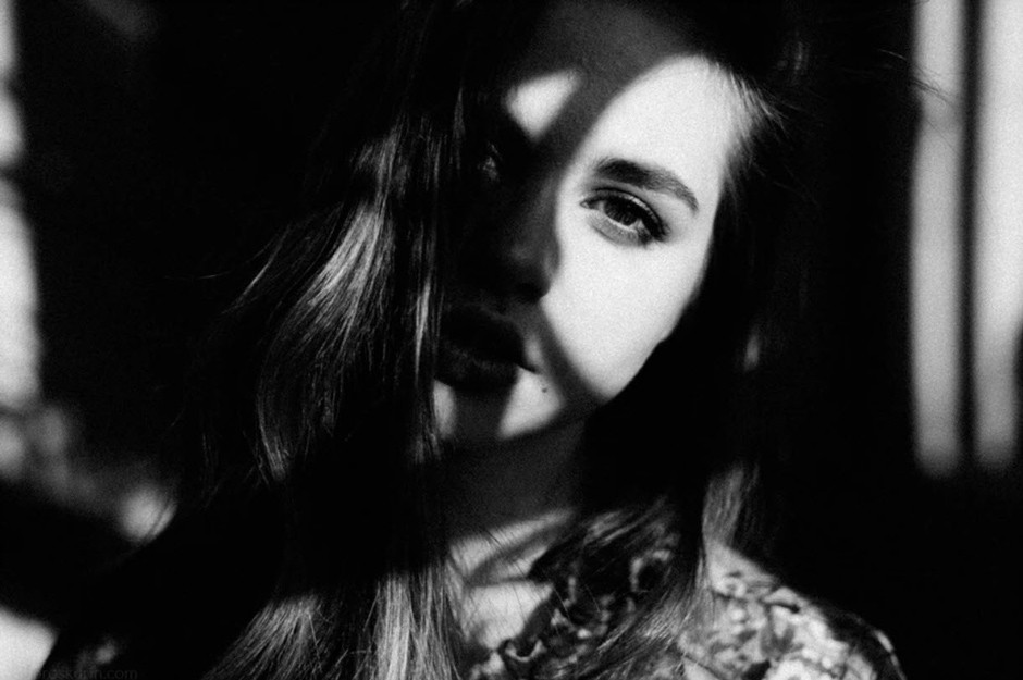 portrait of girl partially covered by shadows