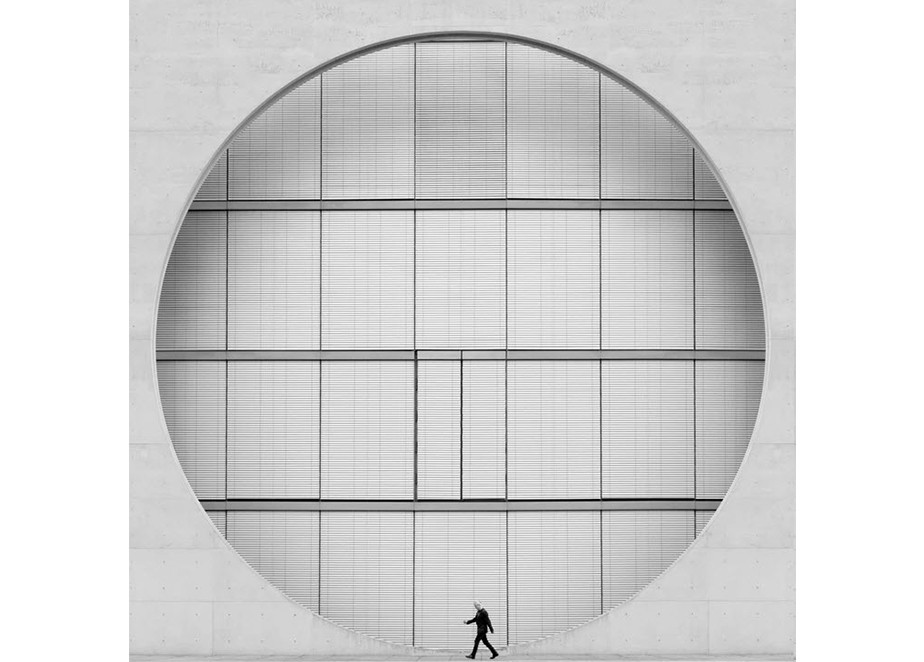 fine art photography minimalist composition black and white man passing geometrical structure
