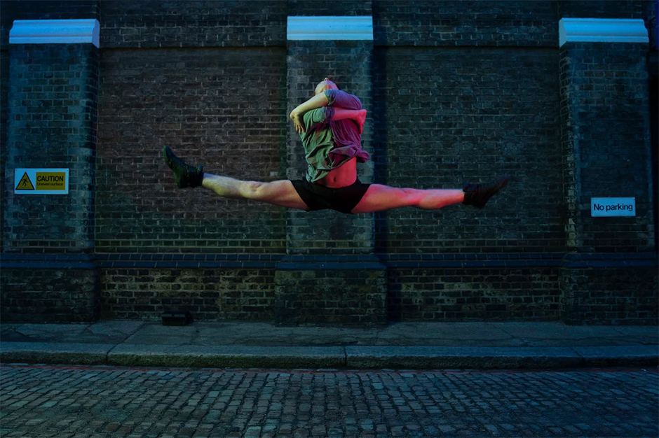man jumping and dancing in the street
