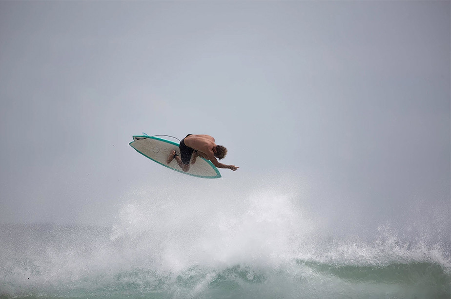 sports photography surfer jumping over wave