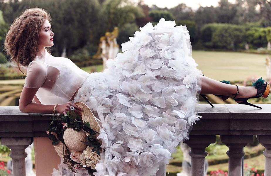 fashion photography girl on white dress laying on balcony