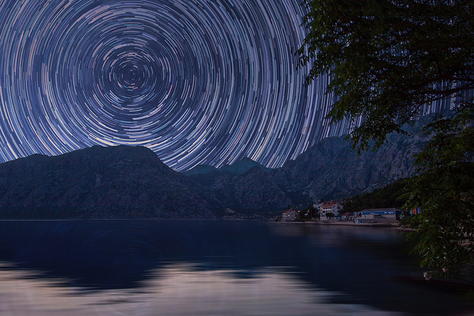 long exposure photography star trails over mountain and lake