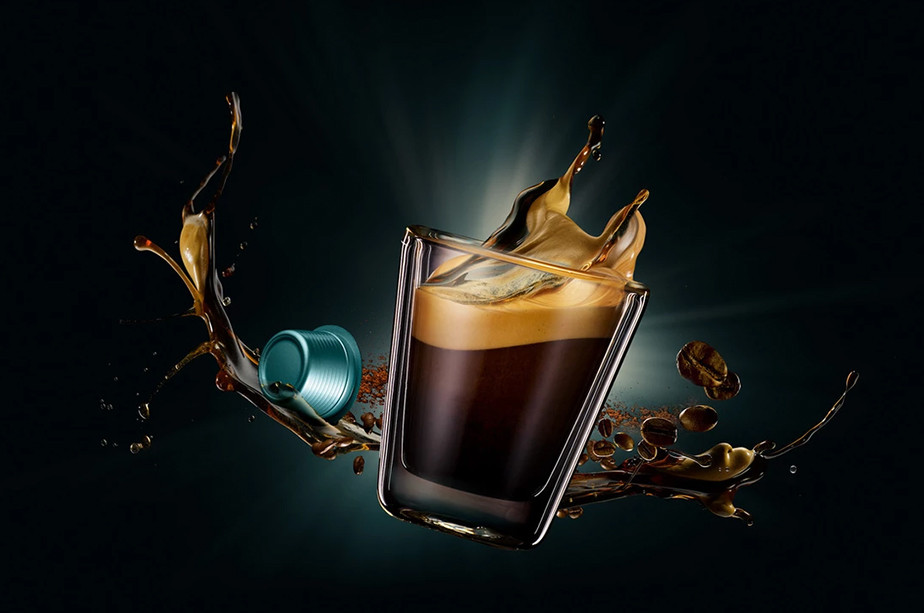 commercial photography coffee splash on glass cup