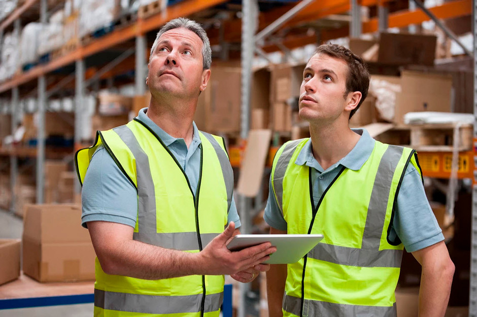 stock photography warehouse workers with reflective vests