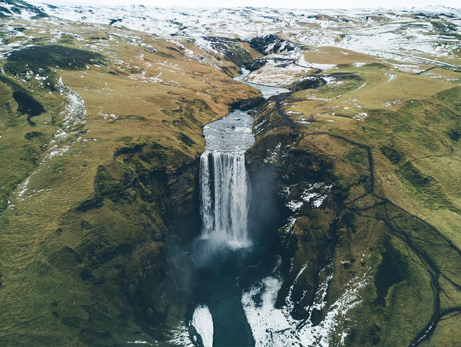 landscape photography iceland waterfall over cliff