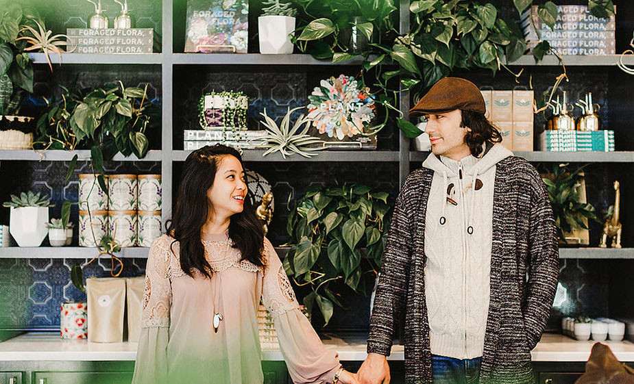 couple photoshoot ideas holding hands on plant store