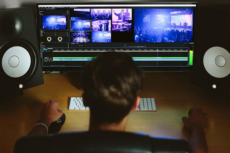 man editing video on computer