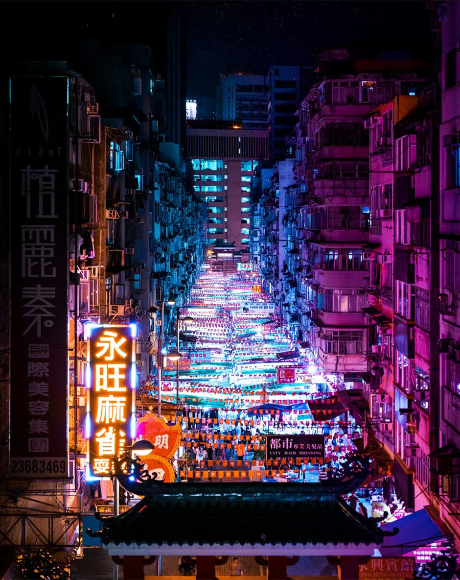 vertical urban landscape of Hong Kong night streets