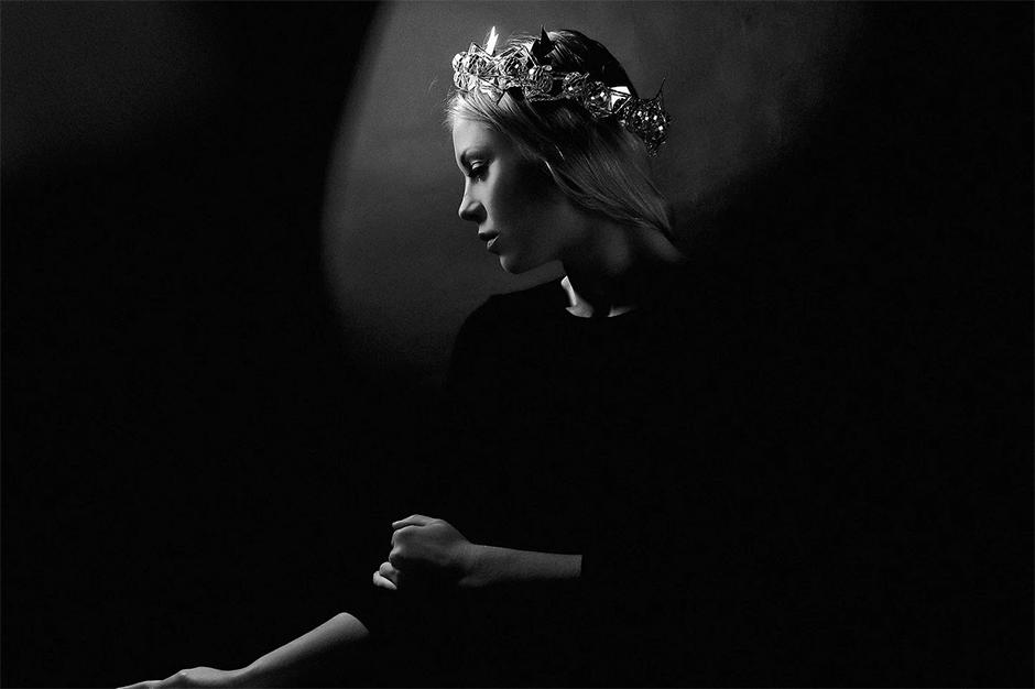 low-key monochrome portrait of girl with crown