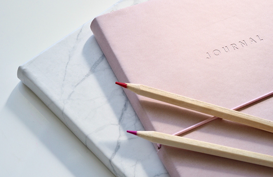 delicate notebooks with color pencils