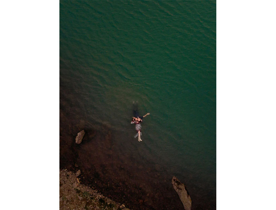 aerial photography couple photoshoot floating on lake water