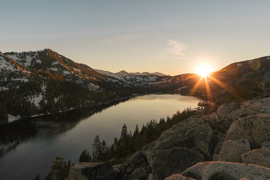 mountain sunset over lake and forest